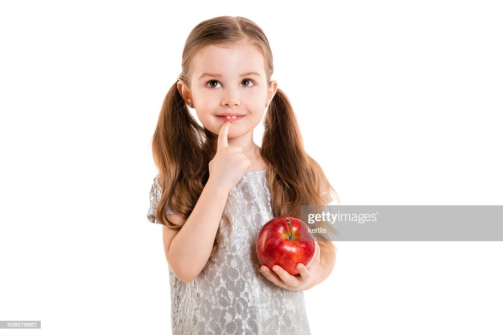 little girl with apple(isolated on white background, isolated) : Stockfoto
