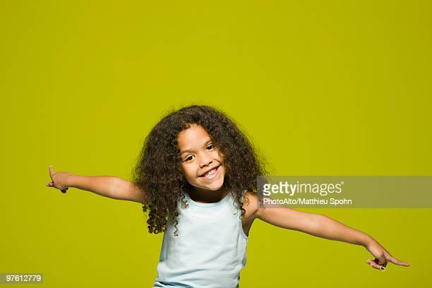 Little girl with arms outstretched, portrait