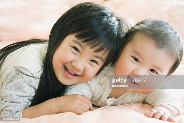 Little girl with baby boy brother