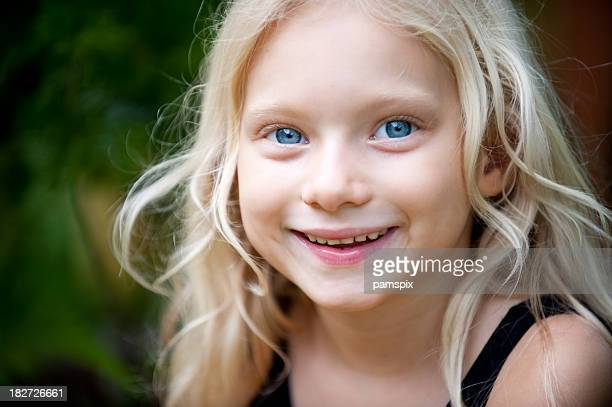 little girl with big blue eyes and blonde hair - blue eyes stock pictures, royalty-free photos & images