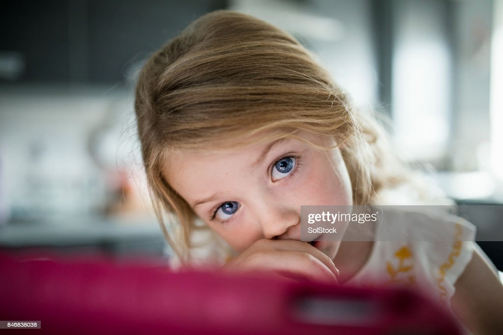 Little Girl with Big Blue Eyes : Stock Photo