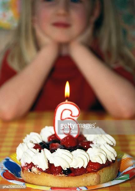 Little girl with birthday cake, portrait.