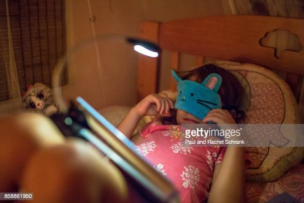 Little Girl With Book, Wearing Blue Bunny Mask, in Pink Bedroom, Bedtime