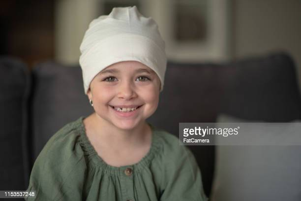 little girl with cancer - infanzia foto e immagini stock
