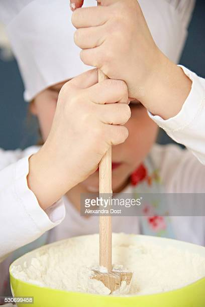 little girl with chef's hat preparing dough, munich, bavaria, germany - alexandra dost stock-fotos und bilder
