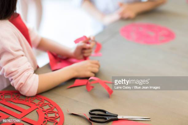 Little girl with Chinese New Year paper-cut
