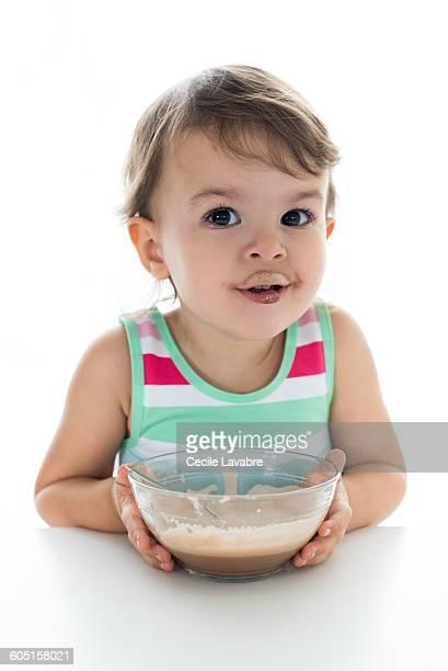 Little girl with chocolate milk mustache