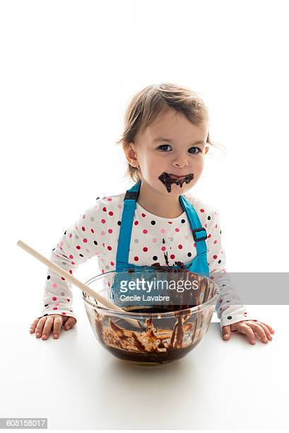 Little girl with chocolate on the mouth