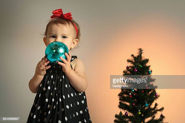 little girl with christmas bauble - heshphoto stock pictures, royalty-free photos & images