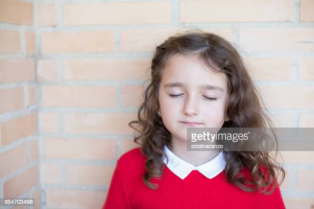 Little girl with closed eyes