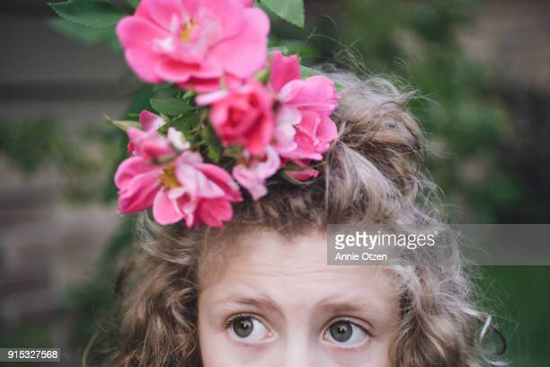 Little Girl With Curly Hair and Roses on Her Head