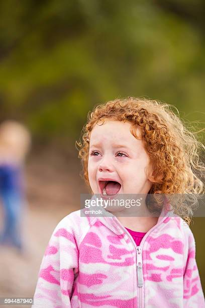 Little Girl With Curly Red Hair Crying