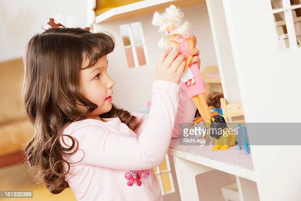 Little Girl with Dollhouse