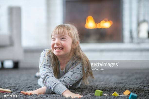 little girl with down syndrome - children only stock pictures, royalty-free photos & images