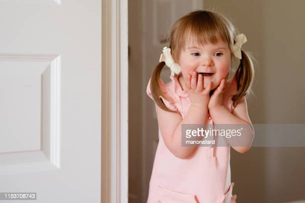 little girl with down syndrome playing with a friend - children only stock pictures, royalty-free photos & images