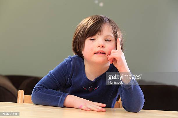 Little girl with Down Syndrome talking