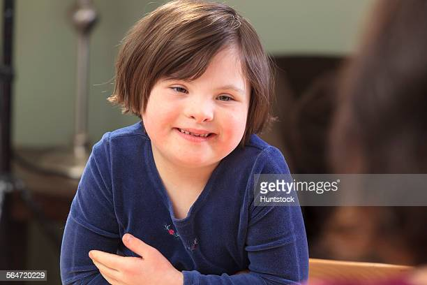 Little girl with Down Syndrome talking to her Mom