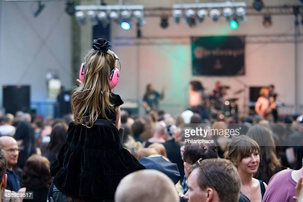 little girl with ear protection on concert - ear protection stock pictures, royalty-free photos & images