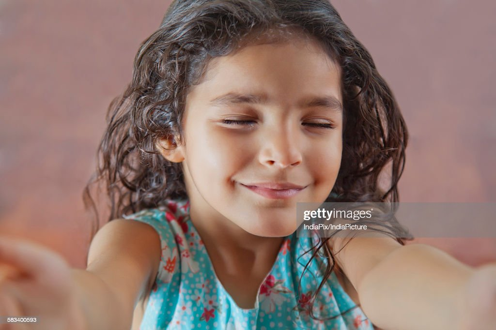 Little girl with eyes closed : Stock Photo