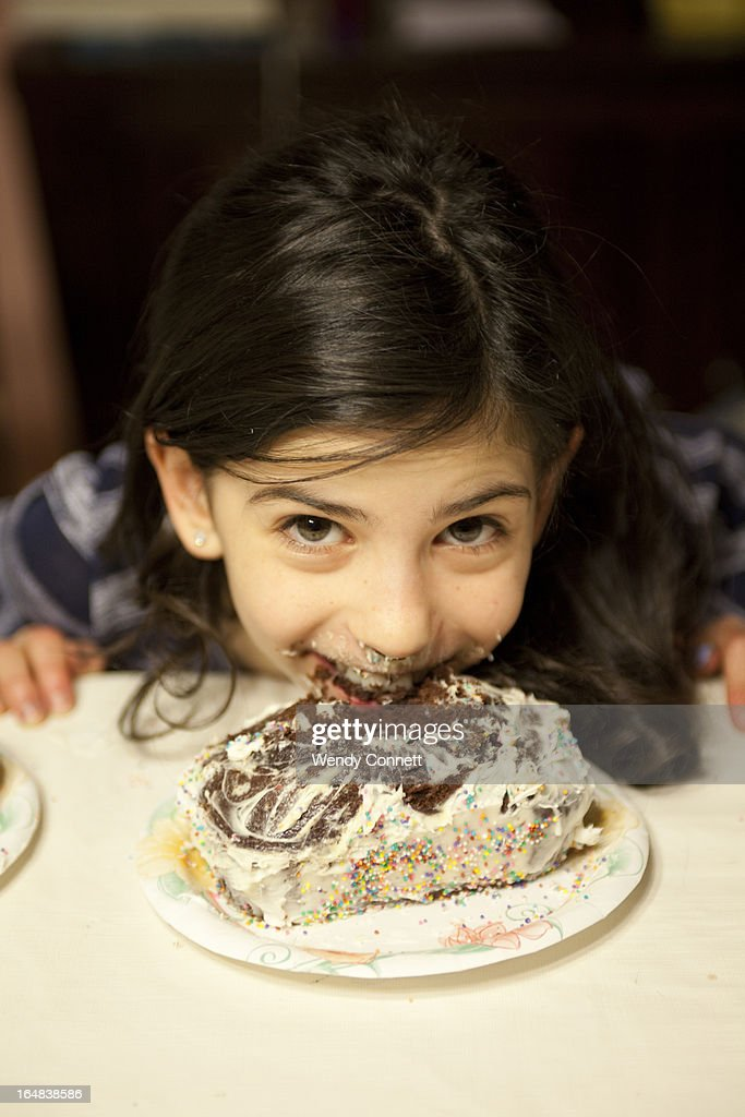 Little Girl With Face In Birthday Cake Stock Photo Getty Images