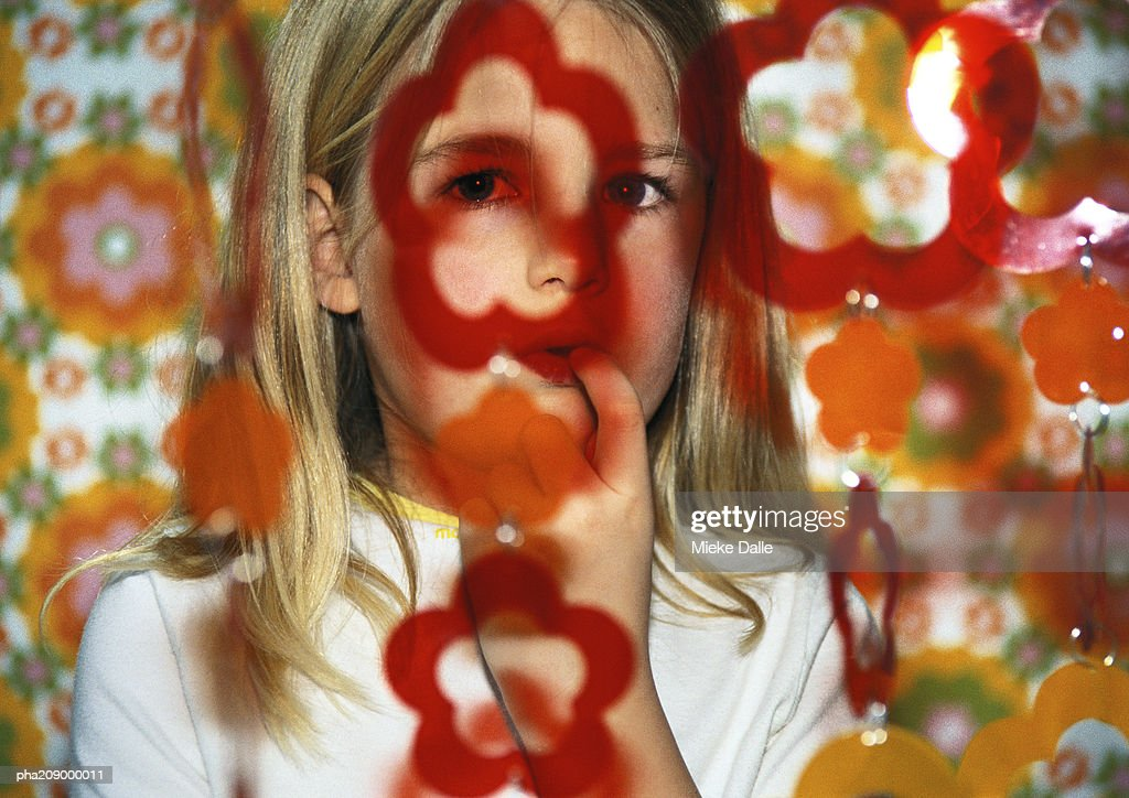 Little girl with finger in her mouth. : Stockfoto