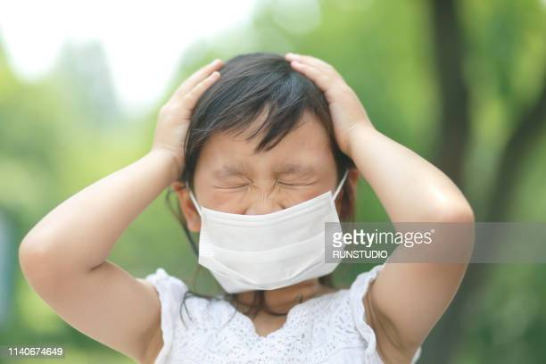 Little girl with flu mask,bad condition
