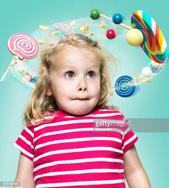 Little girl with flying candies around her head, Composite
