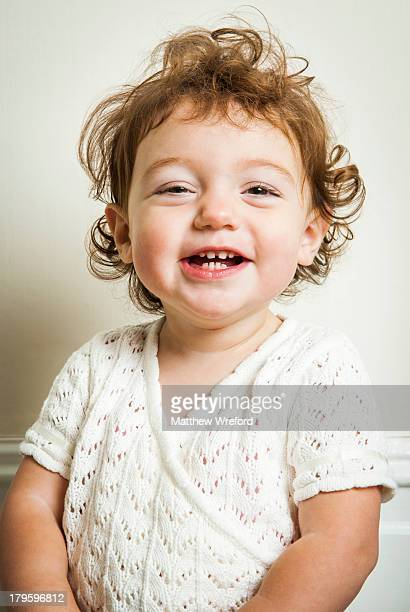 Little girl with gappy teeth smiling.