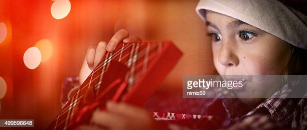 little girl with gift - christmas gifts stock photos and pictures