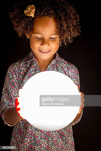 Little Girl With Glowing Ball