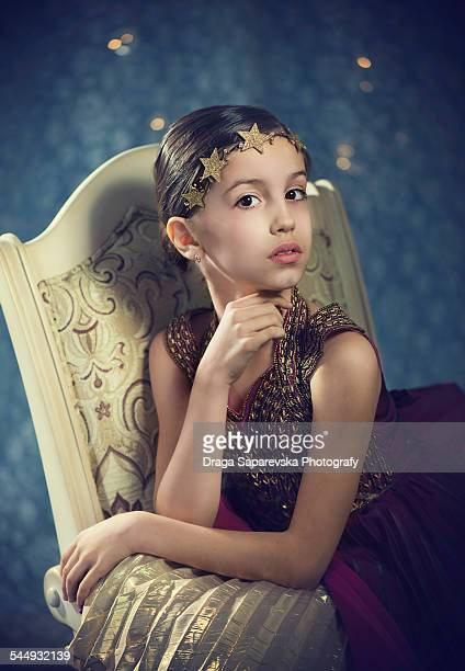 Little girl with golden hair accessory
