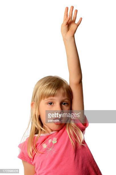 Little Girl with hand raised up on a white background