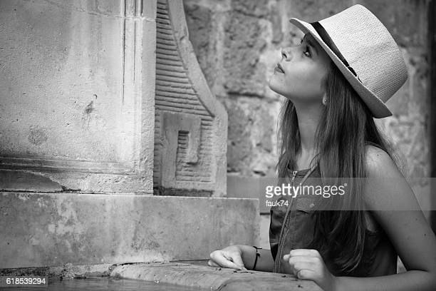 Little Girl with Hat Looking Up