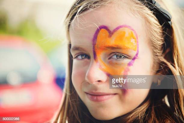 Little Girl with Heart Painted on the Face