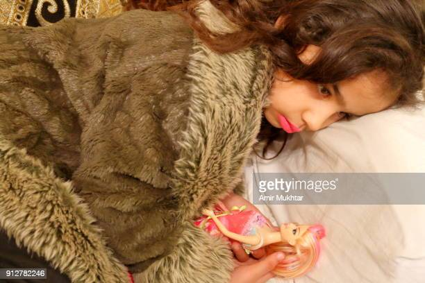 little girl with her doll - cute pakistani boys stock photos and pictures