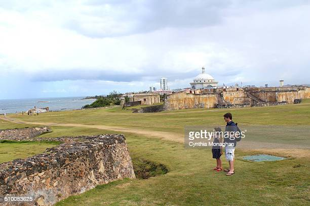 Little girl with her father exploring an historic fort in Old San Juan, Puerto Rico.