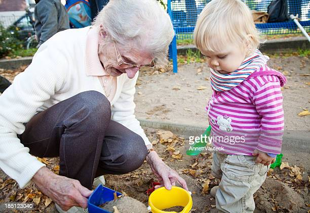 little girl with her great-grandmother - great granddaughter stock photos and pictures