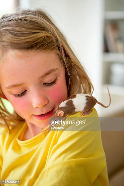 Little Girl with her Pet Mouse