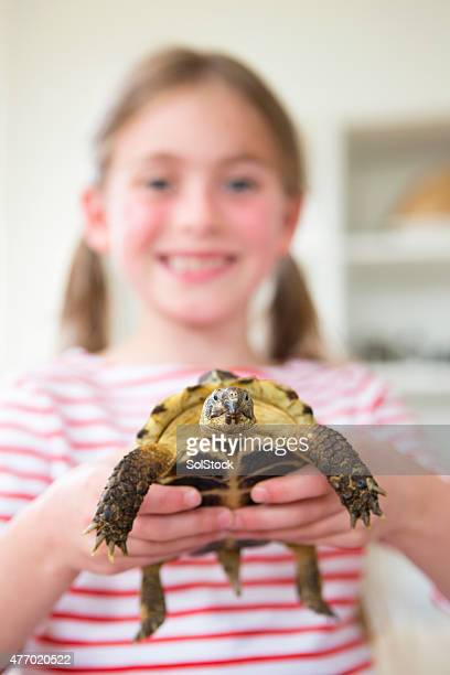 Little Girl with her Pet Tortoise Tommy