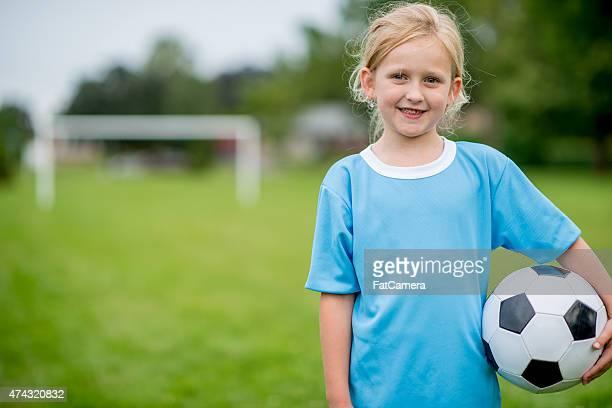 Little Girl with Her Soccer Ball
