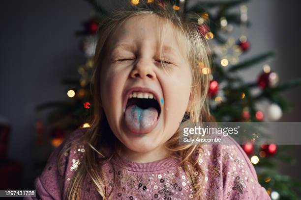 little girl with her tongue out - christmas stock pictures, royalty-free photos & images