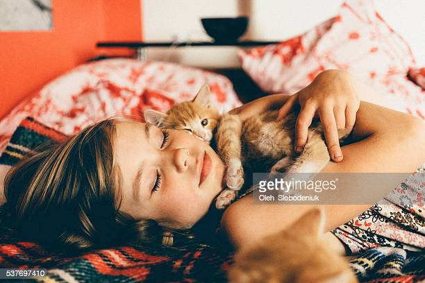 Little girl with kittens