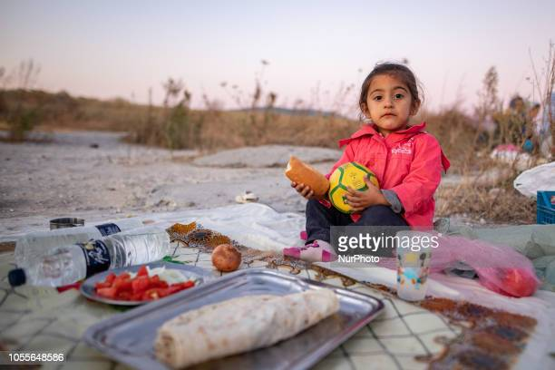 A little girl with Kurdish origins A group of refugees outside in the field near Diavata refugee camp in Thessaloniki Greece on 26 October 2018...