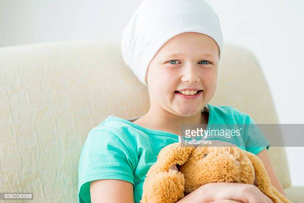 little girl with leukemia - bald girl stock photos and pictures
