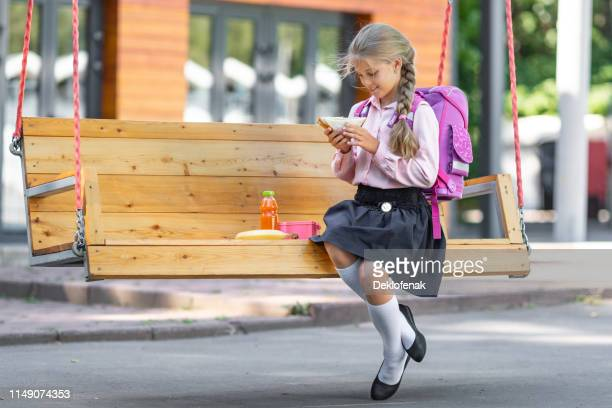 little girl with lunch swing