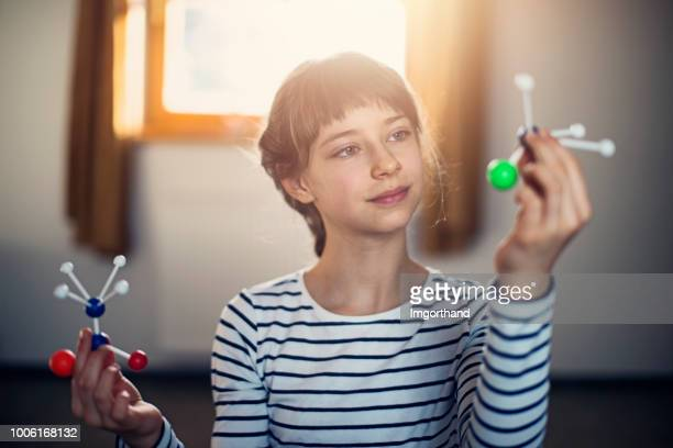 little girl with molecular models - primary age child stock pictures, royalty-free photos & images