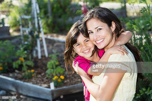 Little girl with mother in garden