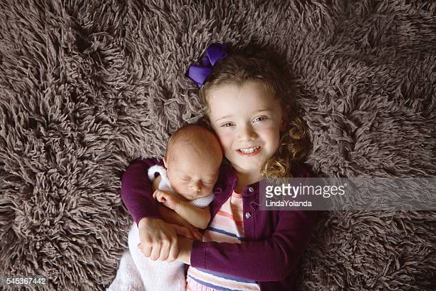 little girl with newborn brother - linda wilton stock pictures, royalty-free photos & images