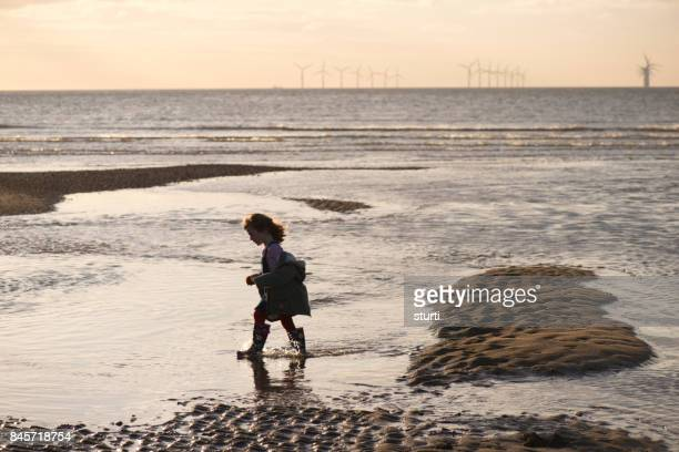 little girl  with offshore windfarm