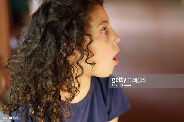 little girl with open mouth - girls open mouth stock photos and pictures